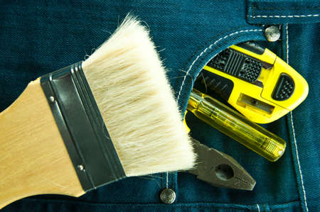 Blue jeans and tools in pocket photo