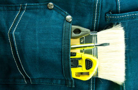 Blue jeans and tools in pocket Stock Photo - 9238777