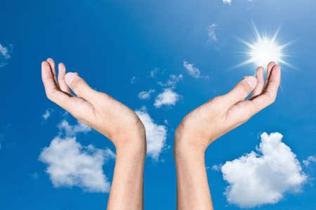 Hand and sky photo