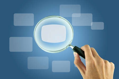 Magnifying glass and the working paper with a diagram. (Business concept) Stock Photo - 9308169