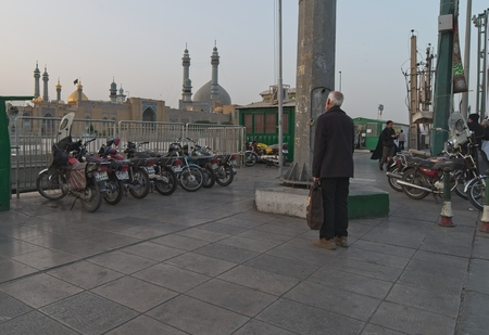 An Iranian man in front of the mosque.The holy shrine in Qom city of Iran 스톡 콘텐츠