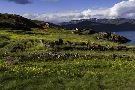 The view of Narsarsuaq in Greenland, old remains of the village in the front and current village in the background.