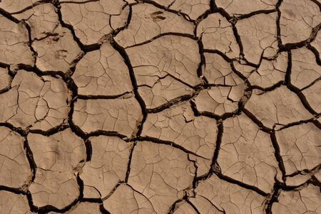 Desert dry and cracked ground, Chad. Africa Archivio Fotografico - 144286118
