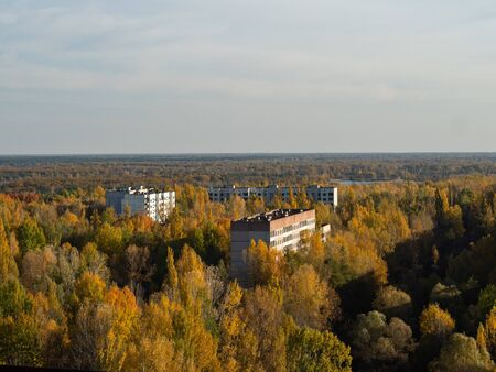 View from roof of ghost town Pripyat, post apocalyptic city, autumn season in Chernobyl exclusion zone, Ukraine 写真素材