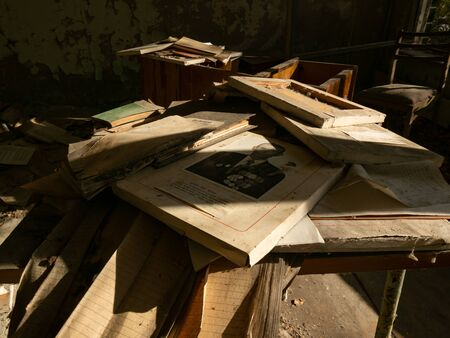 Left over books and notebooks in school in the Pripyat ghost town. Chernobyl Exclusion Zone. Ukraine 写真素材