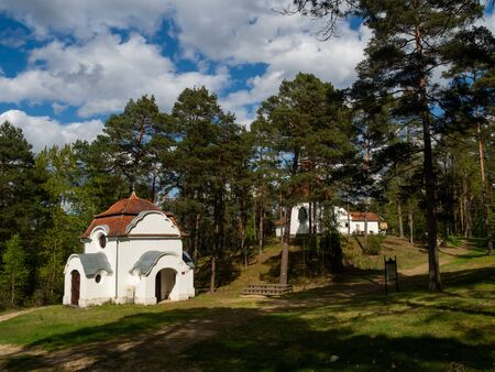 Chapels being part of the Way of the Cross, surrounded by the forest. Wiele, Kaszuby, Poland. Early spring.