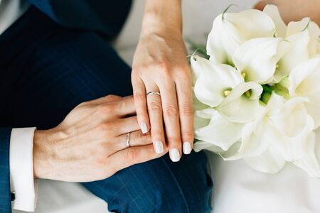 Close up groom and bride hands  with rings. Wedding day