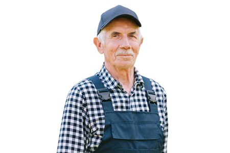 Senior professional worker in overall and cap. Aged farmer. Old craftsman. Isolated on white background