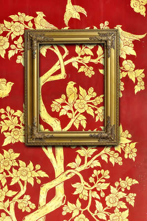 Golden picture frame on Thai traditional pattern wall for decoration Stock Photo - 8670698