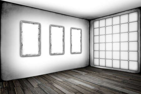 Grunge white room with old frames on a wall photo
