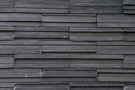 Dark stone tile texture brick wall surfaced photo