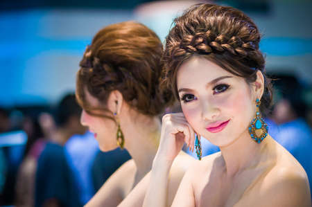 BANGKOK - MAR 28: An unidentified female presenter models at the BRG booth during the Thailand International Motor Expo at Impact Muang Thong Thani on Mar 28, 2012 in Bangkok, Thailand.