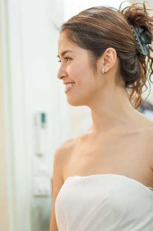 A Portrait of Beautiful Asian Woman in Wedding Dress photo