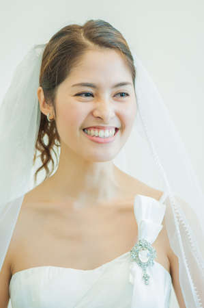 A Portrait of Beautiful Asian Woman in Wedding Dress Stock Photo