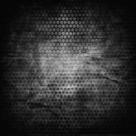 malla metalica: Grill met�lico en el agujero en la textura del grunge lienzo las arrugas Foto de archivo