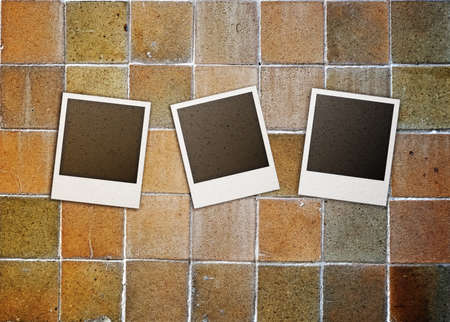 confines: Grunge photo frames on tile background