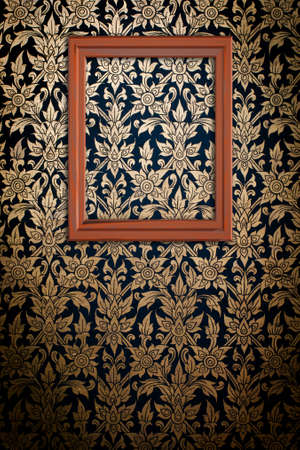 Picture frame on Thai traditional pattern wall for decoration photo