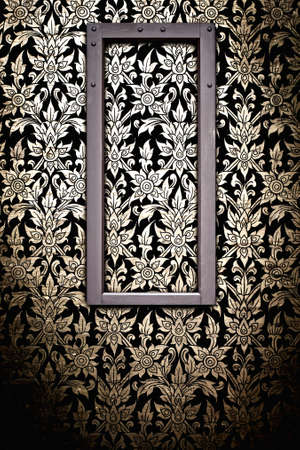 Wooden picture frame on Thai traditional pattern wall for decoration photo