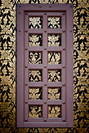 Old door frame on Thai pattern background photo