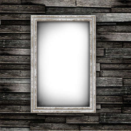 Grunge wood floor with old frames on a wall
