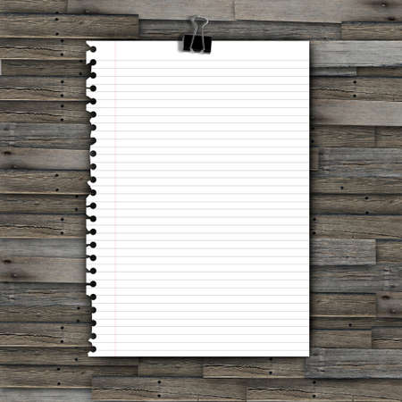 Note paper and paper clip on wooden background photo