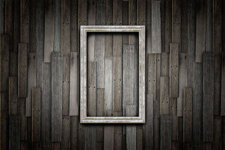 Grunge frame on wood wall