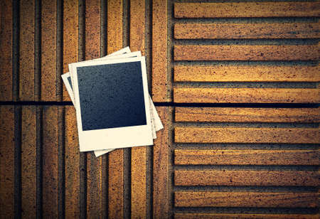 confines: Photo frames on wood background
