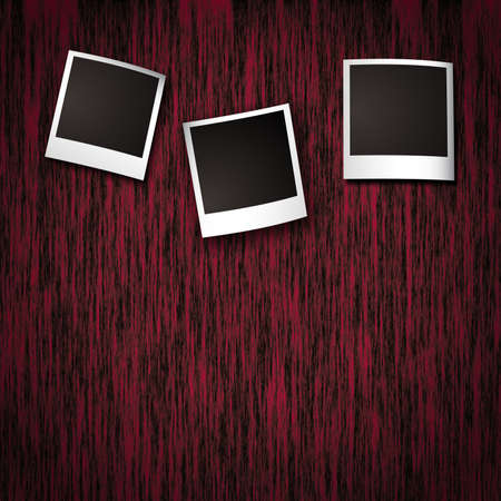 Photo frames on red wooden texture background photo