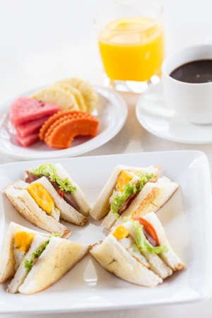 Delicious breakfast  sandwich orange juice and coffee