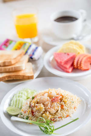 Breakfast Shrimp fried rice with orange juice coffee and fruit Standard-Bild