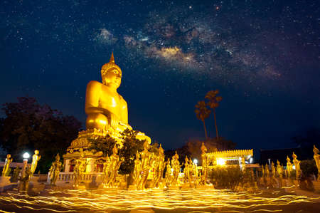 THE NIGHT WITH MILKY WAY, BUDDHA STATUES AND CANDLELIGHT PROCESSION: On Makha Bucha - a religious observance day.