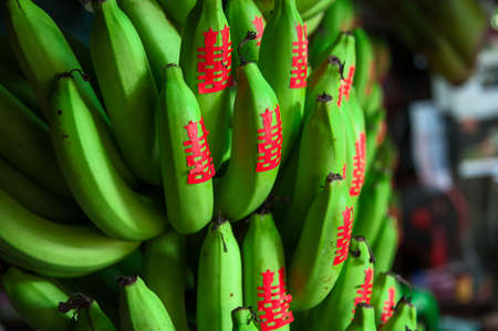 seller: Banana for offering. In Chinese tradition, banana is considered as a sacred offering fruit to the lord Buddha. Each banana will have a red Chinese symbol - meaning DOUBLE HAPPINESS, pasted on. This symbol is also used for wedding ceremony and festival.