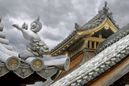Japanese Architecture. Lion Figure Roof Guardian. Kyoto, October 23, 2016: Myoshinjy Temple, mystical roof guardians commonly used as part of roof ornaments in ancient Japanese and Chinese architectures.