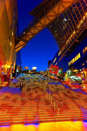 prank: Halloween Illumination at Kyoto Station. Kyoto station, Japan - October 17, 2016: Colourful Halloween lighting display on the 171 steps of grand staircase at shopping mall level inside the station.