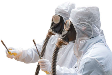 Two men in bio-hazard suits and gas masks. Two men in bio-hazard suits, both wear gas masks with flexible rubber breathing tubes. One of them holds a pair of rusty steel bar. Vectores
