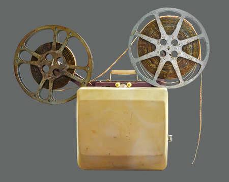 Vintage portable Film Cinema Projector on isolated gray background 版權商用圖片