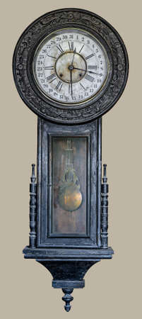 Antique swing wall clock. Pendulum clock on isolated beige background