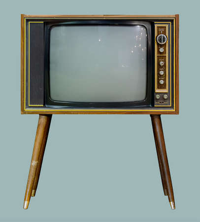 Vintage TV : old retro TV set in wooden cabinet on isolated green background with clipping path. 版權商用圖片
