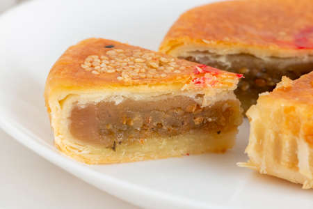 Traditional Teochew mooncake with savoury lotus paste containing preserved Chinese mustard. Also known as 'la-pia' by Malaysian Chinese. Hand-crafted Mid-Autumn Festival pastry.