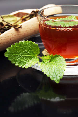 teahouse: Tea. Herbal tea. Mint leaf. Tea in a glass cup, mint leaves, dried tea, sliced lime. herbs on a slate plate in a restaurant or teahouse Stock Photo