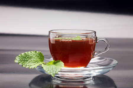 Tea. Herbal tea. Mint leaf. Tea in a glass cup, mint leaves, dried tea, sliced lime. herbs on a slate plate in a restaurant or teahouse Stock Photo
