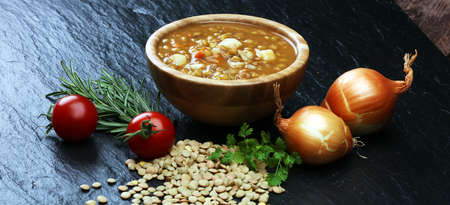 Lentil soup with pita bread in a bowl on a wooden background