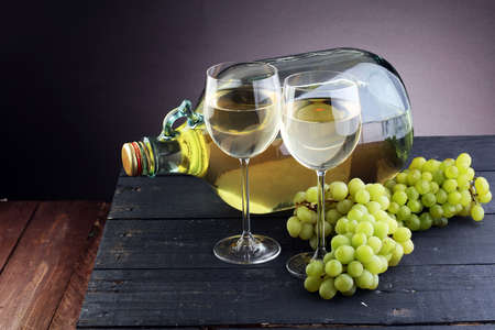 Bottle and glass of white wine, grape
