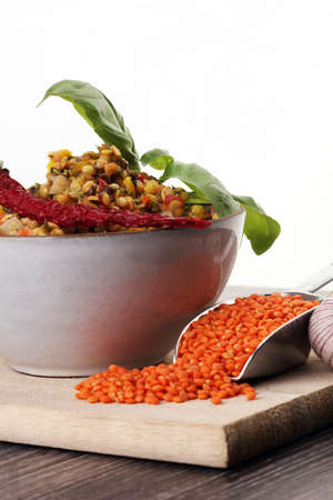 Lentil curry salad with carrot, cauliflower, broccoli and onion in a bowl. Healthy lifestyle. Diet menu