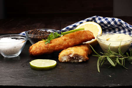 traditional British fish on black background