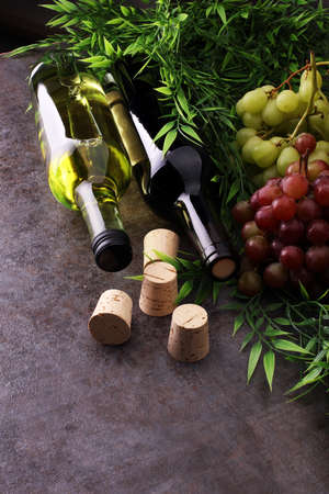 Bottle of white and red wine, grape and corks Stock Photo