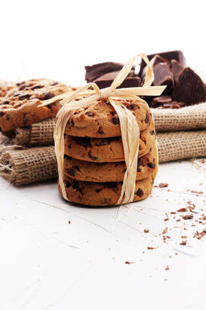 morsels: Chocolate cookies on white background with chocolate morsels