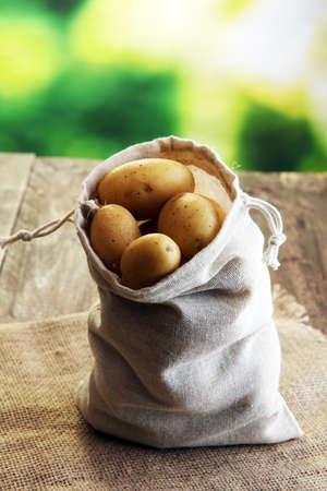 heap: Pile of potatoes lying on wooden boards. Fresh potato Stock Photo