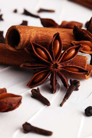 asian flavors: cinnamon, staranise and cloves. winter spices on white background Stock Photo