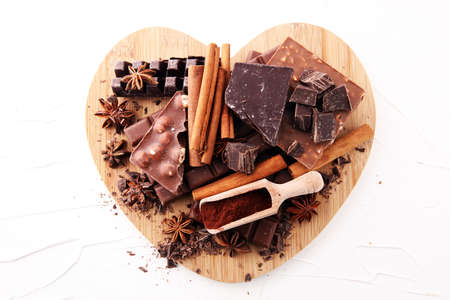 Chocolate concept with assorted chocolate, powder and spice.